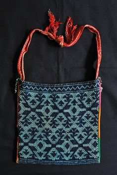 Huichol Bag Mexico    This morral or shoulder bag was woven in a Huichol community in northwest Mexico, probably in Jalisco or Nayarit state. It is said to date from the 1950's. Both the bag and the strap were woven using a backstrap loom.