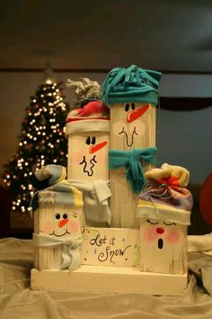 snowmen - a DIY project. Looks like 2X4s and a 1X2 or 3 for the sign. What a cute idea!