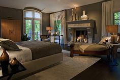 guest room, master bedroom, fireplace, chaise lounge, area rug, gray, neutral tones, lighting, nightstand