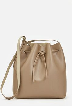 This faux leather bucket bag will be your new go-to. It features a minimal design and drawstring closure for instant style and functionality. ...