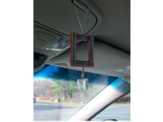 Photo frames for rearview mirrors! All frames are super lightweight, made from rigid plastic sports card protectors.