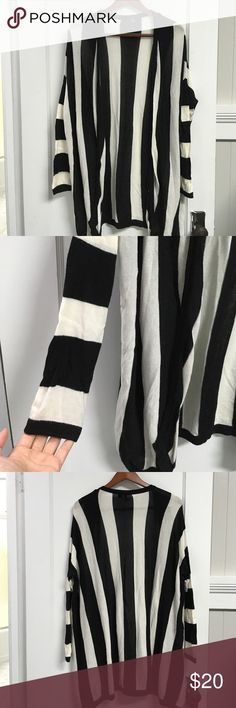 "H&M vertical striped cardigan black and off white vertical striped cardigan, purchased from H&M. no closures at front, it's meant to be worn open. very oversized- great for layering. it was one of my favorites for many years. some linting from movement, but nothing crazy. approx 33"" long. H&M Sweaters Cardigans"
