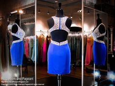 Check out this amazing royal blue jersey formfitting short homecoming dress. Its V-neck bodice is completely covered with clear crystal stones and features a back zipper. The sexy open back is to die for and it's at Rsvp Prom and Pageant, Atlanta, GA! 115VP015030