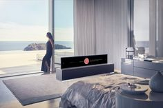 For decades TVs have been black boxes that dominate our interiors. But now we're seeing the design of innovative TVs that blend into the background. The new LG Signature Roll-up TV disappears into a box when not in use. Oled 4k Tv, Lg Oled, Lg Televisions, Tvs, Las Vegas, Smartphone, Audio Room, Home Technology, Home Tv