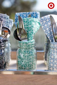 Target Home Style Expert, Emily Henderson, likes to make self-serving extra easy for her guests. These DIY personal utensil cups are super easy. Make one for each guest using a dinner napkin and a place setting, neatly folded into a Mason jar. Then, tuck in a fork, knife and spoon and they're ready to go.