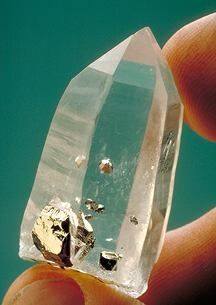 Pyrite inclusions in Quartz - wow - such a great piece of quartz...and the way that pyrite's floating in it...magic!