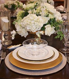 """""""A beautiful table is not about a staggering investment in expensive formal objects. My style is distinctly American, with a commitment to simplicity. I see endless opportunities in a crisp white napkin. And white, silver, and gold are just the perfect trio."""" — Phoebe Howard, Interior designer and retailer, Jacksonville"""