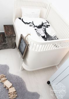 whitewashed floors, rustic stool, and crazy cool crib