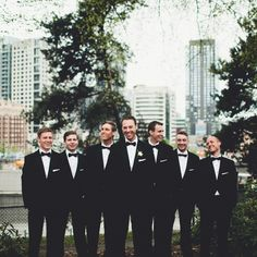 Groomsmen wore traditional black tuxedos with matching black bowties. Groom only with boutonnière