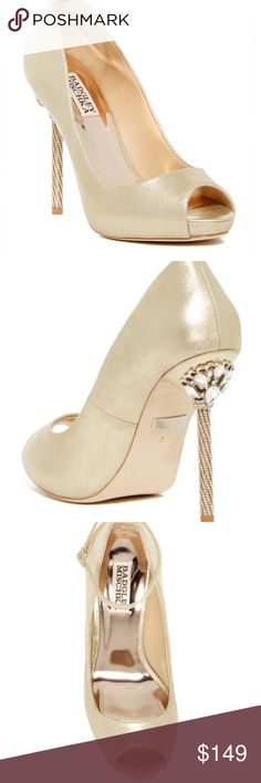 """Badgley Mischka Diego II Gold Metallic Pumps 8 Dazzling crystal embellishment magnifies the retro-chic glamour of Badgley Mischka Diego II peep-toe leather pump fitted with an ankle strap and elevated by a slender stiletto heel. - Peep toe - Ankle strap with adjustable buckle closure - Lightly padded footbed - Embellished stiletto heel - Approx. 4.5"""" heel, 0.75"""" platform.  - Color: Gold Metallic. - Size: 8. Ankle straps are missing on both shoes. It's a perfect classic pump.  Brand new with…"""