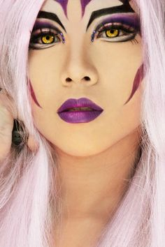 Vibrant purple make-up with blue crystal accents inspired by Ultimecia from Final Fantasy.