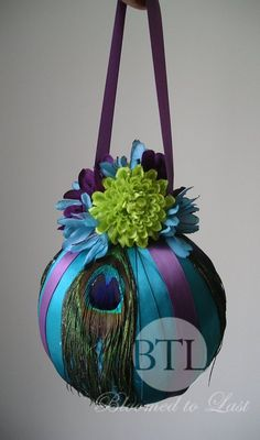 Peacock Feather Pomander/Kissing Ball in Teal, Lime Green, Purple. $65.00, via Etsy.