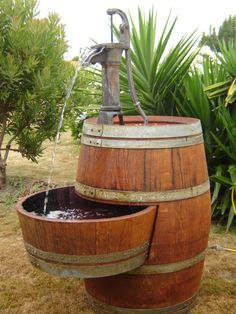 Wine barrel water feature. I'd try to make this functional by adding a third feature low enough for my dogs to drink from!