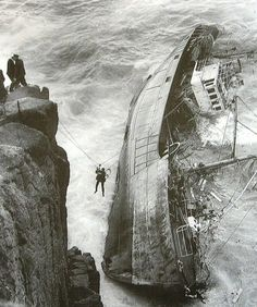 <> A crew member is rescued from a French ship which ran aground at Lands End, Cornwall. 12 men lost their lives. 1962