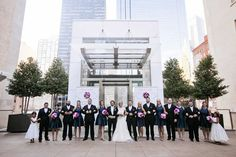 Entire bridal party posing outside on rooftop of The Joule after formal wedding ceremony at The Joule in Dallas, TX - Photo by Jenny & Eddie
