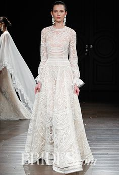 """Brides.com: . """"New Mexico"""" ivory thread-embroidered wedding dress with gathered long sleeves, Naeem Khan"""