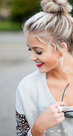 A top knot is a great way to get gorgeous with minimal effort. Gather hair up into a high ponytail, secure with a hair tie, and twist the ponytail around into a tight twist.