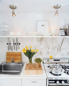 Even a small space can be well designed.  Yellow with stainless, white, wood