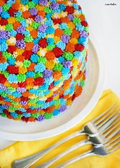 To frost this cake use the grass tip as you normally would, but don't extend the tip to achieve the long grass.  Just short little dabs of frosting.