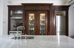 wood cabinet millwork + marble counter