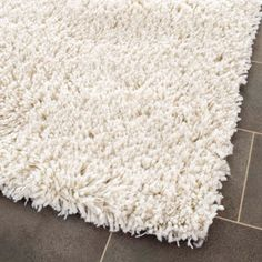 A white shag rug was the perfect cozy touch for the kid's room.  This one is $310, but I found a similar one at Ross for $40.