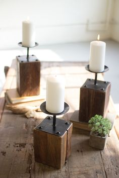 Add some beauty and warmth to your home with this set of Recycled Wood Candle Holders. This set of 3 Rustic Wood Candle Holders feature a wooden base with raised metal candle cups. Rustic Candles, Rustic Candle Holders, Candle Holder Set, Pillar Candles, Reclaimed Wood Projects, Scrap Wood Projects, Recycled Wood, 4x4 Wood Crafts, Wood Projects That Sell