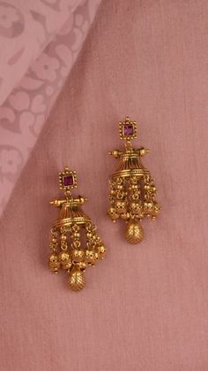 Tiered gold earrings accented with the vibrance of a pink stone Gold Jhumka Earrings, Jewelry Design Earrings, Gold Earrings Designs, Necklace Designs, Antique Earrings, Gold Necklace, Gold Haram Designs, Gold Bangles Design, Gold Jewellery Design
