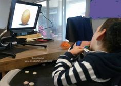 Dexter using his eyes to crack the egg... wherever his eyes are looking on the screen, the cursor moves. He has been playing some games, learning to use the technology and working on developing his focus and vision. #cvi