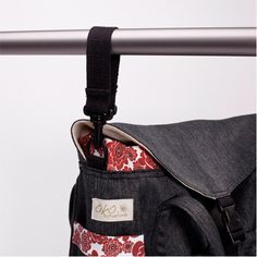 It hangs perfectly off your stroller!  S'attache facilement à la poussette!  Our redesigned Hemp Demin Diaper bag with a waterproof nylon interior!   Notre sac à couche en denim de chanvre repensé avec un intérieur en nylon rigide!