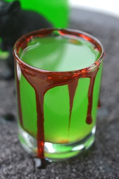 My Halloween Cocktail - The Poison Frog is fun and dangerous! The flavor is green apple and its similar to moonshine. This is a party in a jar!