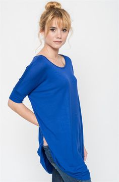 Introducing our top selling tunic, now available in short sleeves. This soft jersey-knit pullover is the perfect piece for your everyday wardrobe. Versatile in look and comfortable in style, this Ballet Sleeve Tunic is an easy pair to your leggings, jeans, or just bare legs! Soft to the touch and easy to wash and wear over and over again, this is your perfect piece to every season of the year.Available in 10 Colors: RoyalMochaCoralOatmealMintTaupeFuchsiaBlackPeachHeather GreyThis g...