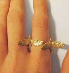 Double birds ring. Wish it was black or silver