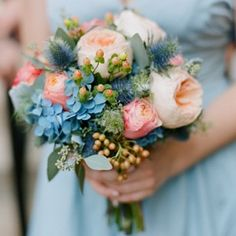 Clutch bouquets of blue purple green hydrangeas, blue thistle, coral spray roses, green succulents, queen anne's lace, peach hypericum berries, and seeded eucalytpus wrapped in coral ribbon. Add a touch more purple and this is PERFECT!!!