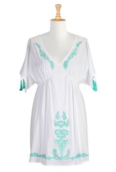 White tunic top with v-neck, kimono sleeves with open undersides, drawstring shoulders with turquoise tassels on drawstring ends, and turquoise embroidery along neckline and bottom | eShakti
