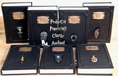 Oh my gosh... leather bound Harry Potter collection with wands on the binding and removable Horcrux bookmarks. I need this in my life.