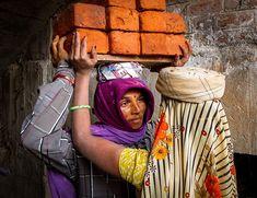 This image is part of my folio on construction workers of #India. #18px.photography #indiagrams #streetphotographydelhi #indiashutterbug #ingersofindia #click_india_click  #oficial_photography_hub #indiashutterbugs #clickindiaclick #_soimumbai #indiaphotographyclub #_coi #traveldesi #lonelyplanetindia #desi_diaries #_soi #brickworkers #labour #labor #couple #work #bnw #colour #backandwhite #travel #antislavery #anti-slavery #bricks #orange