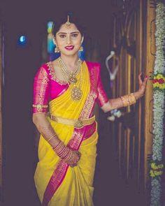 South Indian bride. Indian bridal jewelry.Temple jewelry. Jhumkis. Yellow and pink silk kanchipuram sari. Braid with fresh flowers. Tamil bride. Telugu bride. Kannada bride. Hindu bride. Malayalee bride.Kerala bride.South Indian wedding. Pinterest: @deepa8