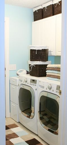 Small laundry room organization. Love the baskets and colors
