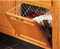 """KV Tilt Out Wire Hamper 10 1/2"""" Wide White by Knape & Vogt. $35.51. Looking for convenience? Our Tilt-Out Hamper attaches to a bottom hinged cabinet door and allows you to open the door and access the basket in one easy motion. Mounting lugs included."""