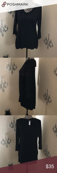 Belldini black with silver high-low tunic Perfect with leggings or jeans! This beauty has a high-low hem, with very reflective silver rhinestone accents on the front and along the three-quarter-length sleeves. Lightweight and flowy. Belldini Tops Tunics