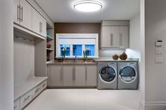 Drool! Yes, a dream laundry/mud room does exist!