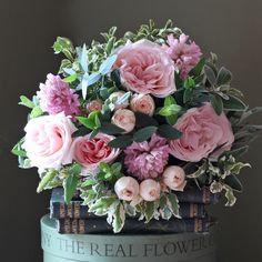 Exquisite scented garden blush pink roses mixed with hyacinth and hand tied with garden herbs and foliage.