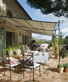 La Belle Jardin: sunbrella panels for metal canopy ... and shutters on doors
