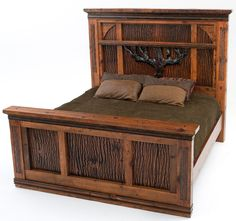 Experience the comforting warmth and mystery of the deep woods every evening. This rustic hand hued barn wood bed is wrapped in chestnut stained bark. Above your head you are sheltered by a majestic hand carved oak tree. This antique wood bed paired with naturally harvested tree bark panels whispers the words rustic elegance and