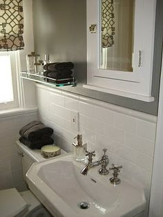 """benjamin moore greystone - this is the color - Revere Pewter looked too much like """"navajo white"""" contractor boring color in my house- So this is a couple shades darker in the same warm tones - it looks great in this bathroom w/the white and brown accents"""
