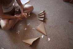 Making brown paper confetti cones