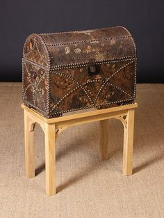18th Cent. Dome Topped Chest clad in tooled & painted leather, with brass studs 18 x 22.5 x 13""