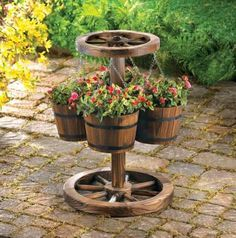 Repurposing a Wagon Wheel as a flower pot holder/stand