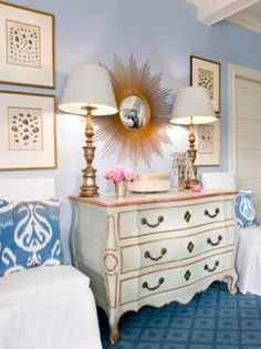 White and gold painted dresser, lamps, framed shell prints, ikat pillows, patterned carpeting - Sara Tuttle