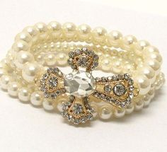 Gorgeous cross and faux pearl bracelet!